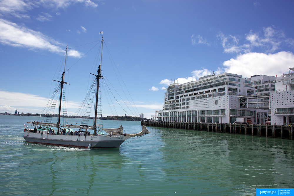 Tourists on the Historic Scow which sails from the NZ Maritime Museum, pass the Hilton Hotel on Auckland Harbour. Auckland, New Zealand, 3rd November 2010. Photo Tim Clayton