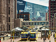 03 MAY 2017 - MINNEAPOLIS, MN: The lightrail and a skyway with the US Bank Stadium in the background. The skyways are enclosed pedestrian overpasses that connect downtown buildings. The Minneapolis Skyway was started in the early 1960s as a response to covered shopping malls in the suburbs that were drawing shoppers out of the downtown area. The system grew sporadically until 1974, when the construction of the IDS Center and its center atrium, called the Crystal Court, served as a hub for the downtown skyway system. There are 8 miles of skyways, connecting most of the downtown buildings from Target Field (home of the Minnesota Twins) to US Bank Stadium (home of the Minnesota Vikings). In the last five years many upscale downtown apartment buildings and condominium developments have been added to the system, allowing downtown residents to live and work downtown without going outside.    PHOTO BY JACK KURTZ
