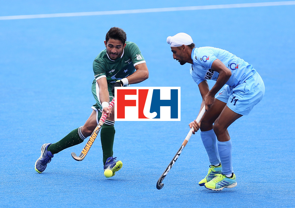 LONDON, ENGLAND - JUNE 24: Abu Mahmood of Pakistan and Mandeep Singh of India battle for possession during the 5th-8th place match between Pakistan and India on day eight of the Hero Hockey World League Semi-Final at Lee Valley Hockey and Tennis Centre on June 24, 2017 in London, England. (Photo by Steve Bardens/Getty Images)