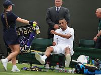 Tennis - 2019 Wimbledon Championships - Week One, Tuesday (Day Two)<br /> <br /> Men's Singles, 1st Round: Nick Kyrgios (AUS) v Jordan Thompson (AUS)<br /> <br /> Nick Kyrgios  flops into his chair after winning the match  on Court 3<br /> <br /> COLORSPORT/ANDREW COWIE