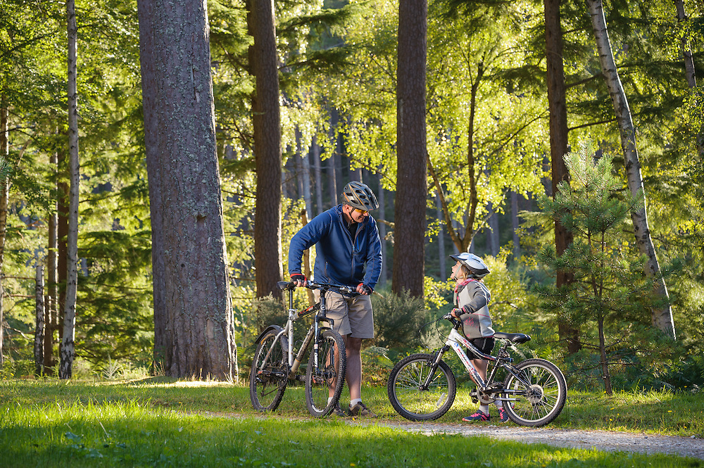 Family cycling at Winding Walks, Aberdeenshire and Moray Forest District, Forestry Commission Scotland
