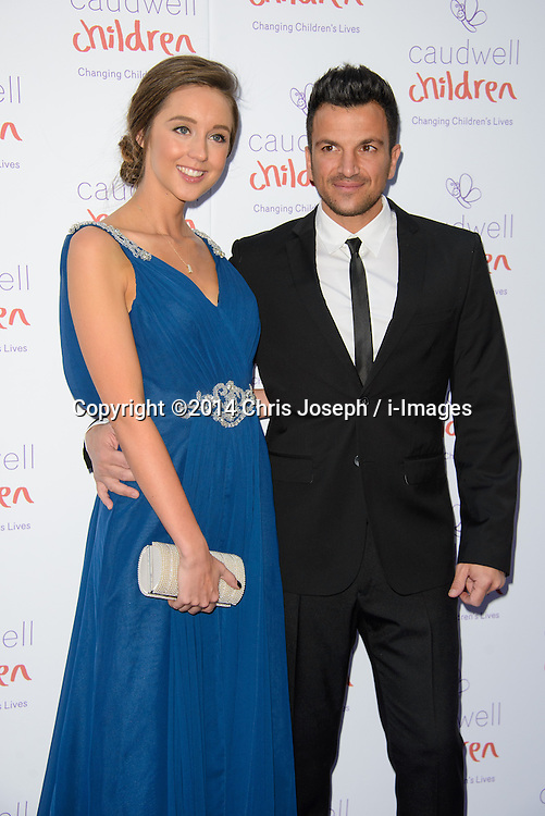 Peter Andre and Emily MacDonagh attend the Caudwell Butterfly Ball. Grosvenor House Hotel, Park Lane, London, United Kingdom. Thursday, 15th May 2014. Picture by Chris Joseph / i-Images