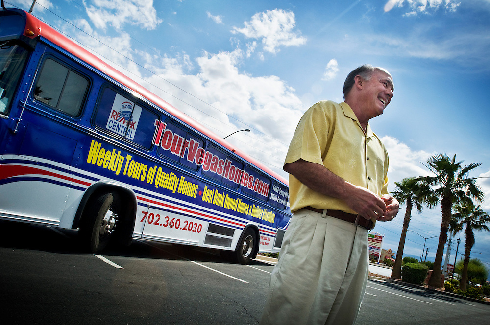 "Greyhound trip..Foreclosures in Las Vegas - John Ahlbrand at Remax in Las Vegas takes interested buyers on ""Foreclosure Tours"" in a bus that tours bank-owned properties...Photographer: Chris Maluszynski /MOMENT"
