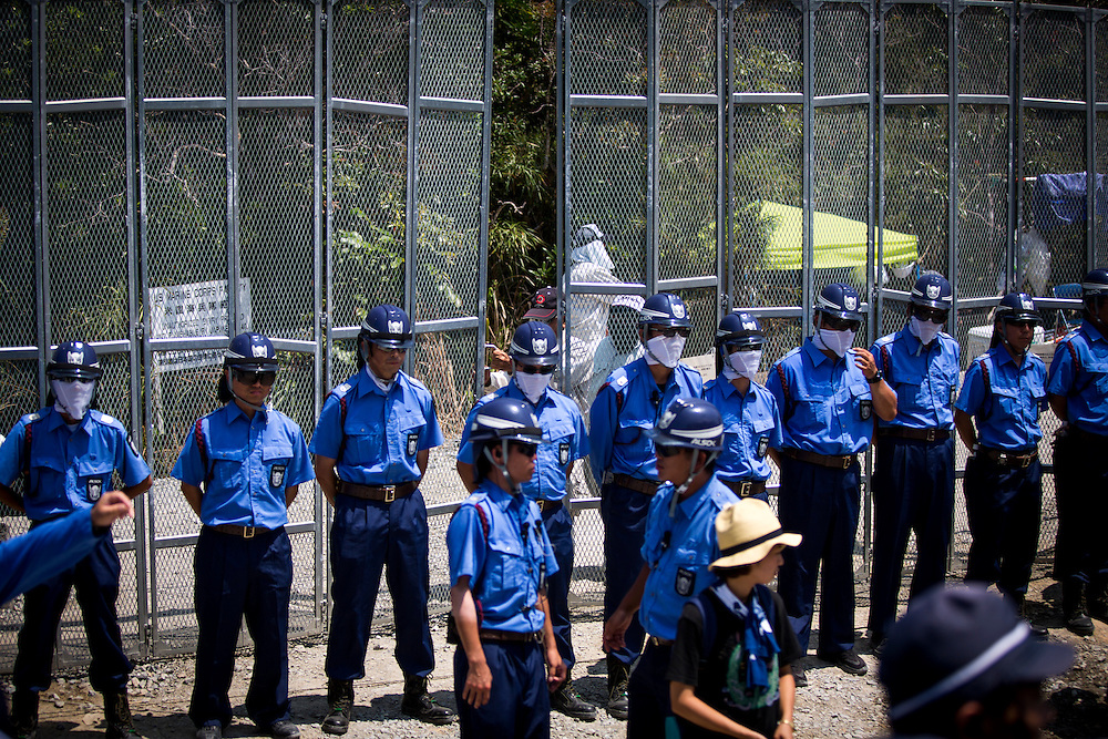 OKINAWA, JAPAN - AUGUST 19 : Security guards the entrance at the U.S. military's Northern Training Area in the village of Higashi, Okinawa Prefecture, on August 19, 2016. Japanese government resume construction of total six helipads in a fragile ten million year old Yanbaru forest that is home to endemic endangered species such as the Okinawan rail and Okinawan wood pecker. (Photo by Richard Atrero de Guzman/NURPhoto)