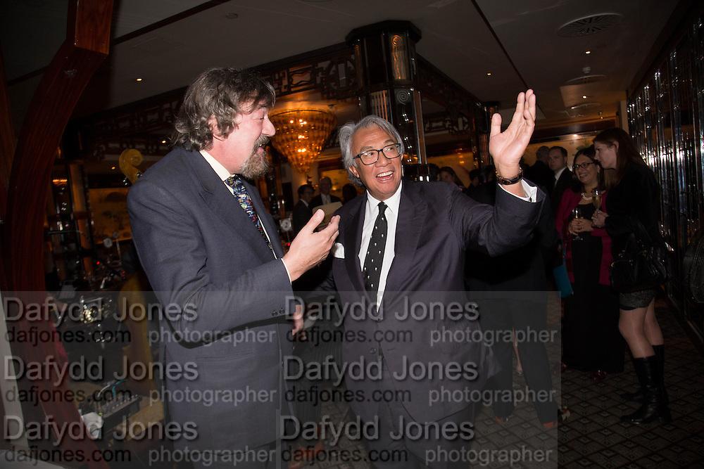 STEPHEN FRY; SIR DAVID TANG, Dinner in aid of the China Tiger Revival hosted by Sir David Tang and Stephen Fry  at China Tang, Park Lane, London. 1 October 2013. ,