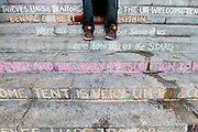 The steps of city hall have been adorned in chalk with various sayings in Los Angeles, Calif. on Sunday, November 19, 2011. (Photo by Gabriel Romero ©2011)