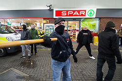 © Licensed to London News Pictures . 30/01/2016 . Dover , UK . Protesters use sticks and placards as weapons . Demonstrations by far-right groups (including The National Front , The North West Infidels and The South East Alliance ) and , opposing them , anti-fascists , close to the port of Dover in Kent . Photo credit : Joel Goodman/LNP
