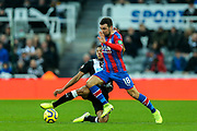 Isaac Hayden (#14) of Newcastle United slides into a challenge on James McArthur (#18) of Crystal Palace during the Premier League match between Newcastle United and Crystal Palace at St. James's Park, Newcastle, England on 21 December 2019.
