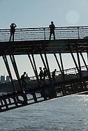 France. Paris. Seine river bridges.  Pedestrians on Solferino bridge ont the Seine river