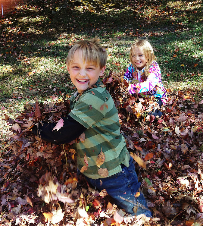 Gary Cosby Jr.  iPhone photographs  Children play in leaves on a fall day.
