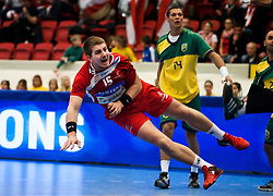 14.01.2011, Himmelstalundshallen, Norrköping, SWE, IHF Handball Weltmeisterschaft 2011, Herren, Österreich vs Brasilien, im Bild, // Austria #15 Fabian Posch scores // during the IHF 2011 World Men's Handball Championship match Austria vs Brazil at Himmelstalundshallen in Norrkoping. EXPA Pictures © 2011, PhotoCredit: EXPA/ Skycam/ Erik Astrom +++++ ATTENTION - OUT OF SWEDEN/SWE +++++