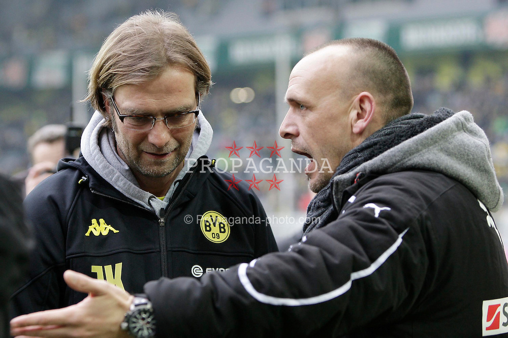 "28.01.2012, Signal Iduna Park, Dortmund, GER, 1. FBL, Borussia Dortmund vs 1899 Hoffenheim, 19. Spieltag, im Bild v.l. Trainer Juergen Klopp (Borussia Dortmund), Trainer Holger Stanislawski (TSG 1899 Hoffenheim) im Gespraech, Freisteller // during the football match of the german ""Bundesliga"", 19th round, between GER, 1. FBL, Borussia Dortmund and 1899 Hoffenheim, at the Signal Iduna Park, Dortmund, Germany on 2012/01/28. EXPA Pictures © 2012, PhotoCredit: EXPA/ Eibner/ Oliver Vogler..***** ATTENTION - OUT OF GER *****"