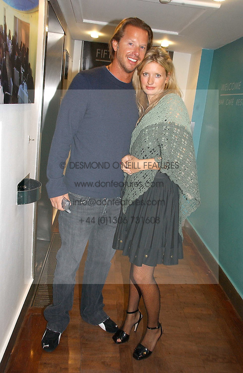 CHRISTOPHER GETTY and LAINEY SHERIDAN-YOUNG at the launch party for the fashion label Javovich-Hawk held at the Fifth Floor Cafe, Harvey Nichols, Knightsbridge, London on 27th April 2006.<br /><br />NON EXCLUSIVE - WORLD RIGHTS