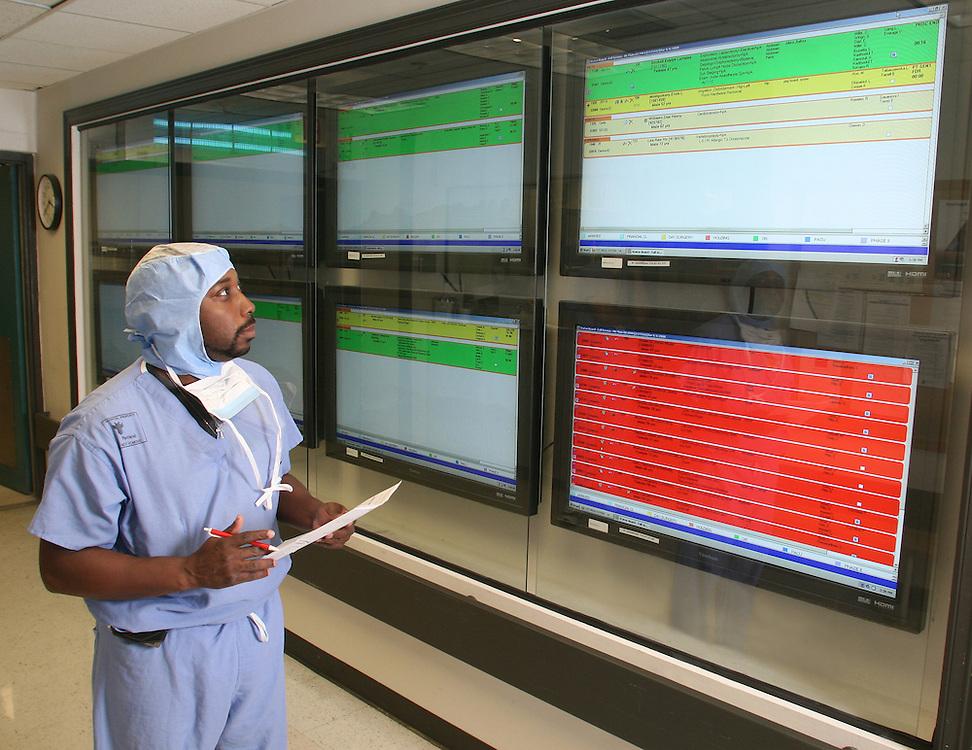 Doctor reading new digital screens
