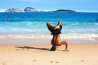 brazilian man dancing capoeira on ipanema beach in rio de janeiro brazil