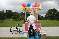 Ice Cream tricycle stand on footpath in public park