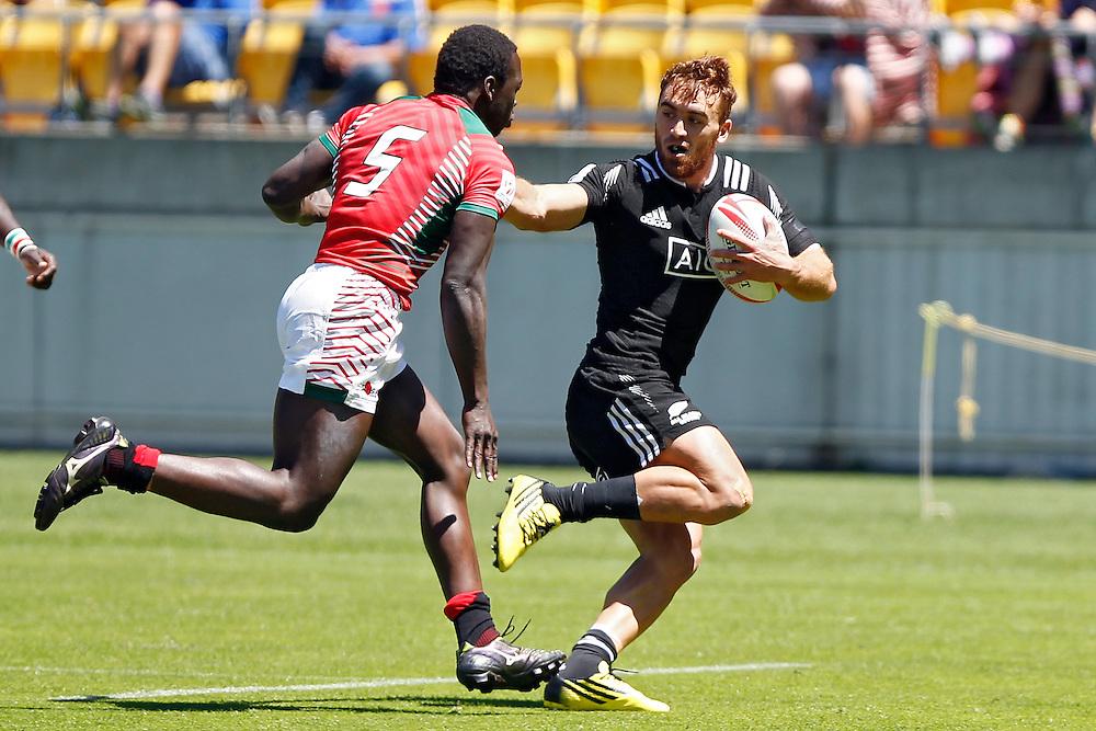 New Zealand's Joe Webber, right, fends off Kenya's Billy Odhiambo, left, in the International Rugby Sevens Tournament at Westpac Stadium, Wellington, New Zealand, Sunday, January 31, 2016. Credit: SNPA / Dean Pemberton