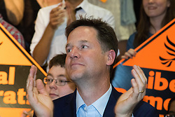 Islington Assembly Hall, London, July 16th 2015. The Liberal Democrats announce their new leader Tim Farron MP who was elected by party members in a vote against Norman Lamb MP. PICTURED: Former Lib-Dem leader Nick Clegg applauds the party's newly elected leader after his speech.