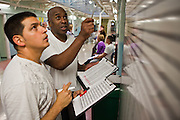 Some existing prisoners work on E wing assigning cells to new inmates on their arrival, using information collected on a questionnaire. HMP Wandsworth, London, United Kingdom