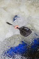 Kayakers playboating on Vail Creek during the TEVA Mountain Games in June  2008.