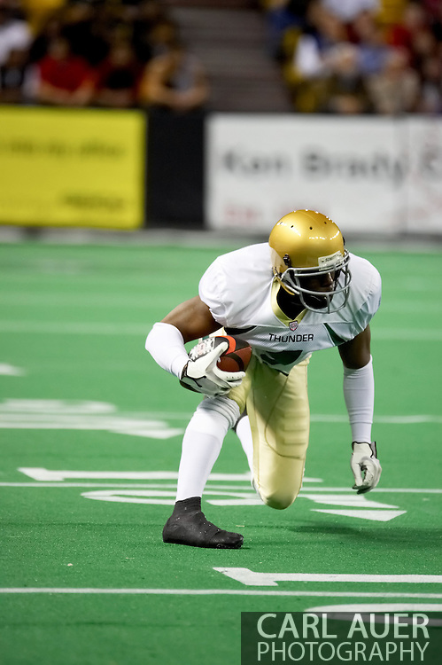 4/12/2007 - Jamaal Denmon of the Frisco Thunder gains a couple yards in the Thunder 46-33 win over The Alaska Wild in the first professional football game in Alaska.