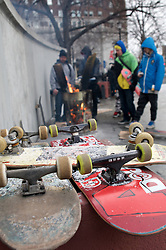 Boards rest as skaters warm by a fire pit during a Feb. 13, 2016 farewell event ahead of the scheduled demolition and redevelopment of the iconic LOVE Park in center City Philadelphia, PA.