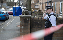 © Licensed to London News Pictures. 26/03/2018. London, UK. An evidence tent (L) covers an area where a man was shot in Hackney. A murder investigation has been launched after a 26-year-old man was discovered in the street suffering from gunshot wounds on Sunday night. Despite the best efforts of paramedics, he was pronounced dead at the scene. Photo credit: Peter Macdiarmid/LNP
