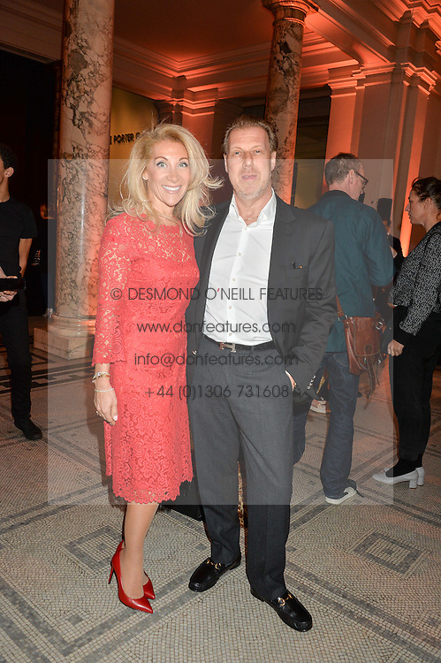 "ALIZA REGER and her husband ANDREW CLAREMONT at a private view of Undressed: A Brief History Of Underwear"" at the V&A, London on 13th April 2016."