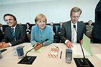 15 JUN 2010, BERLIN/GERMANY:<br /> Hans-Peter Friedrich, CSU, Stellv. Vorsitzender CDU/CSU Bundestagsfraktion, Angela Merkel, CDU, Bundeskanzlerin, Christian Wulff, CDU, Ministerpraesident Niedersachsen und Kandidat fuer das Amt des Bundespraesidenten, (v.L.n.R.), Sitzung der CDU/CSU Bundestagsfraktion, Fraktionssaal, Deutscher Bundestag<br /> IMAGE: 20100615-01-030