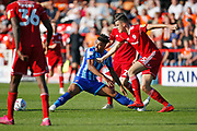 Joe Nuttall of Blackpool  and Ross Sykes of Accrington   contest a loose ball  during the EFL Sky Bet League 1 match between Accrington Stanley and Blackpool at the Fraser Eagle Stadium, Accrington, England on 21 September 2019.