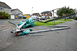 Pictured: <br /> <br /> Stoem Ali was no friend to motorists or householders in Penicuik today with trees bloacking half the road and a cricket cover being blown over a house and into the street; narrowly missing a parrked car.  Thankfully no injuries have been reported but some shed are no long standing true.<br /> <br /> Ger Harley | EEm date
