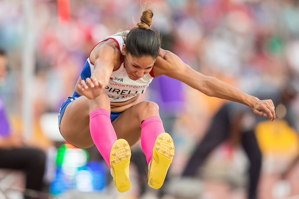 Camila Pirelli of Paraguay competes in the long jump event of the women's heptathlon at the 2015 Pan American Games at CIBC Athletics Stadium in Toronto, Canada, July 25,  2015.  AFP PHOTO/GEOFF ROBINS