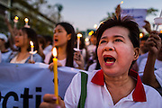 "12 JANUARY 2014 - BANGKOK, THAILAND:  A pro-democracy vigil at Thammasat University in Bangkok Sunday. About 500 people from all walks of Thai life came to the vigil at Thammasat University. They prayed for a peaceful resolution to the political conflict in Thailand. They finished the vigil by singing the John Lennon song ""Imagine."" Anti-government protestors are expected ""Shutdown Bangkok"" Monday. There were reports Sunday evening that some intersections were already being blocked.      PHOTO BY JACK KURTZ"