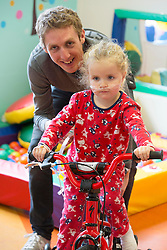 REPRO FREE: 12/11/2014 Irish Profetional Cyclist and world number 9 Dan Martin finished off an eventfull year by visiting the children of Temple Street Hospital. Dan is pictured with Leah Keelan (4) from Castleknock, Co Dublin. Dan presented a cheque to the hospital as part of the Cycle4Life initiative witch has raised €500K to date. Picture Andres Poveda