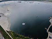 Nederland, Zuid-Holland, Rotterdam, 14-09-2019; Maasvlakte 2 ofwel Tweede Maasvlakte, MV2. Slufter grootschalige opslagplaats voor vervuild slib, voornamelijk  baggerspecie uit de Rotterdamse haven wat vrijkomst bij het onderhoud van de havens. De platen zijn drijvend eilanden voor broedende visdieven. <br /> The Slufter area, Port of Rotterdam, large-scale depot of contaminated harbor sludge from the Port of Rotterdam. In the water  floating islands for nesting common terns.<br /> <br /> luchtfoto (toeslag op standard tarieven);<br /> aerial photo (additional fee required);<br /> copyright foto/photo Siebe Swart