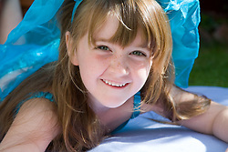 Portrait of a girl in fancy dress smiling,