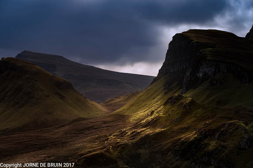 Light falls on the famous hills and mountains of the Quirang on the Isle of Skye, Scotland.