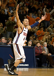 Virginia guard Calvin Baker (4) celebrates after hitting a three point basket against BC.  The Virginia Cavaliers men's basketball team defeated the Boston College Golden Eagles 84-66 at the John Paul Jones Arena in Charlottesville, VA on January 19, 2008.