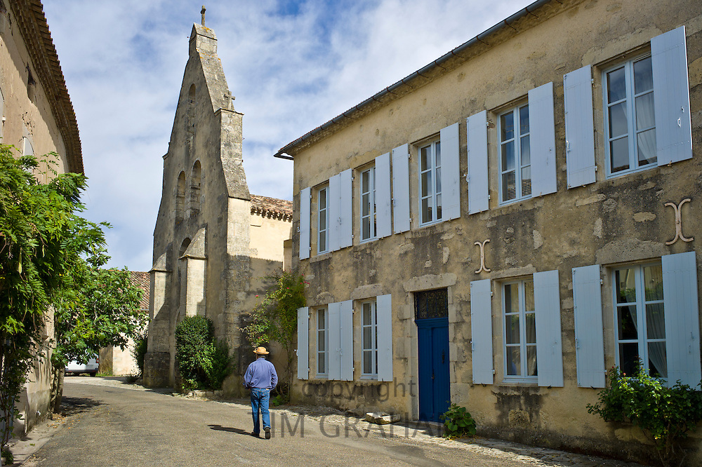 Man strolls in quaint town of Castelmoron d'Albret in Bordeaux region, Gironde, France