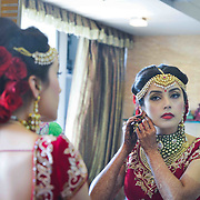 Bride getting dressed in a gujarati wedding.
