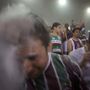 Fluminense fans throw rice powder as their team take the field before the Fluminense V Sao Paulo, Futebol Brasileirao  League match at the Jornalista Mário Filho Maracana Stadium, The fans have a tradition of throwing rice powder as the team takes the field in honour of Carlos Alberto, a player of mixed race ethnicity who, in 1914, attempted to lighten his skin by covering himself in rice powder on debut for his team. Unfortunately his sweat washed the powder off during the match and he was jeered by the opposing supporters..Rio de Janeiro,  Brazil. 29th August 2010. Photo Tim Clayton..