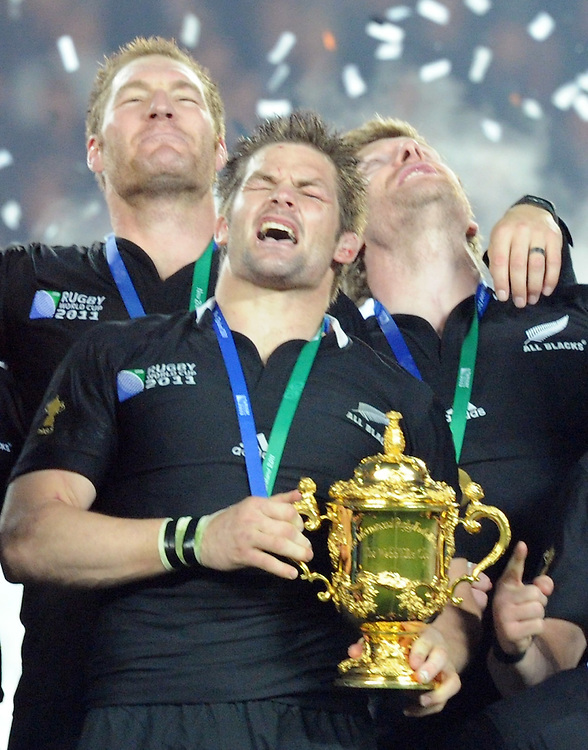 New Zealand captain Richie McCaw with the Rugby World Cup after defeating France in the final at Eden Park, Auckland, New Zealand, Sunday, October 23, 2011. Credit:SNPA / Ross Setford