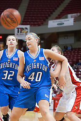 26 February 2006:  Amber Shelton handles an elbow to the face delivered by Amy Hoffman as everyone adjusts for a rebound during a free throw.....Illinois State Redbirds out muscled the Creighton Bluejays on Senior day by a score of 75-61.  Senior Holly Hallstorm grabbed her 10th double double with 20 points and 12 rebounds.  Competition took place at Redbird Arena on Illinois State University campus in Normal Illinois.