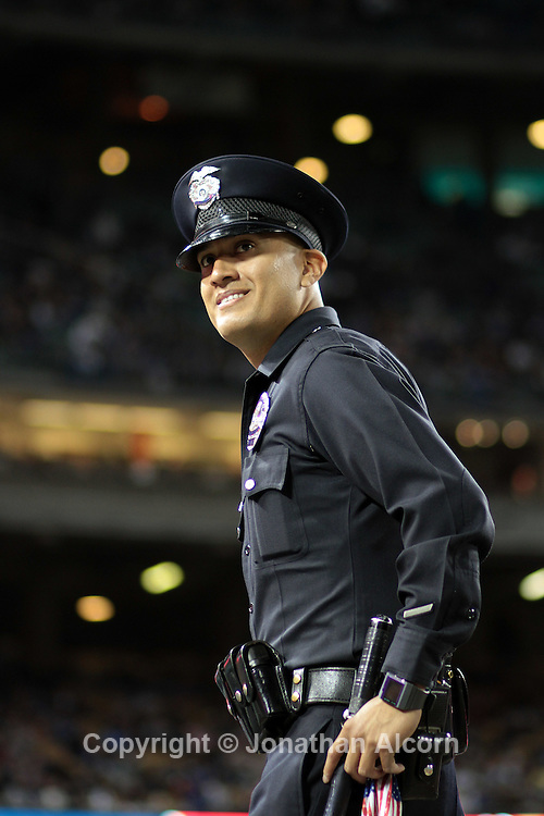 An LAPD officer watches the crowd during the Dodgers  6-1 victory over the Atlanta Braves at Dodger Stadium in Los Angeles on April 20, 2011. Major League Baseball Commissioner Bud Selig announced Wednesday the league office is assuming control of the Los Angeles Dodgers, in the wake of a report team owner Frank McCourt is struggling to pay bills..