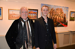 Left to right, JOHN RENDALL and his son NICKY RENDALL at a private view of work by artist Philip Bouchard at 508 Gallery, 508 King's Road, London on 3rd April 2014.