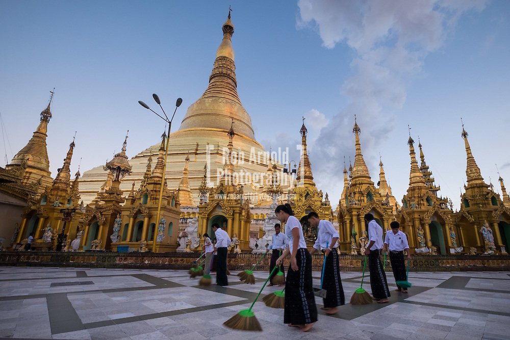 People sweeping the floor at the Shwedagon Pagoda in Yangon, Myanmar.