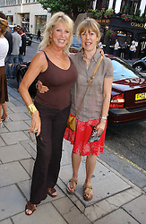Left to right, PATTI BOYD and her sister JENNY BOYD at an exhibition of photographs by David Montgomery entitled 'Shutterbug' held at Scream, 34 Bruton Street, London W1 on 13th July 2006.<br />