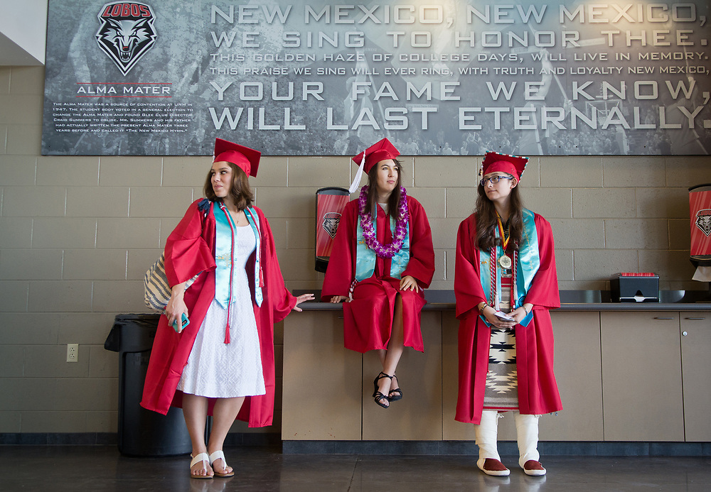 mkb051317c/metro/Marla Brose --  University of New Mexico graduates, from left, Raylee Otero-Bell, Cynthia Sanchez and Kyree Sky, wait inside the Pit before UNM's commencement ceremony, Saturday, May 13, 2017, in Albuquerque, N.M. Otero-Bell earned a B.A. in History, Sanchez in Women's Studies and Sky in Health Medicine and Human Values, are all in pre-med program.  (Marla Brose/Albuquerque Journal)