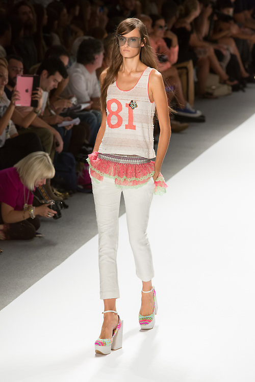 White pants with frilly skirting at the waist and lace top. By Custo Barcelona at the Spring 2013 Fashion Week show in New York.