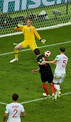 MOSCOW, RUSSIA - Wednesday, July 11, 2018: Croatia's Mario Mandžukić scores the second goal past England's goalkeeper Jordan Pickford in the second half of extra-time to make the score 2-1 to Croatia during the FIFA World Cup Russia 2018 Semi-Final match between Croatia and England at the Luzhniki Stadium. (Pic by David Rawcliffe/Propaganda)